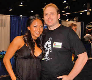 Alan Evans (right) and women's wrestler Gail Kim.